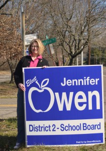 Jennifer Owen sticking signs